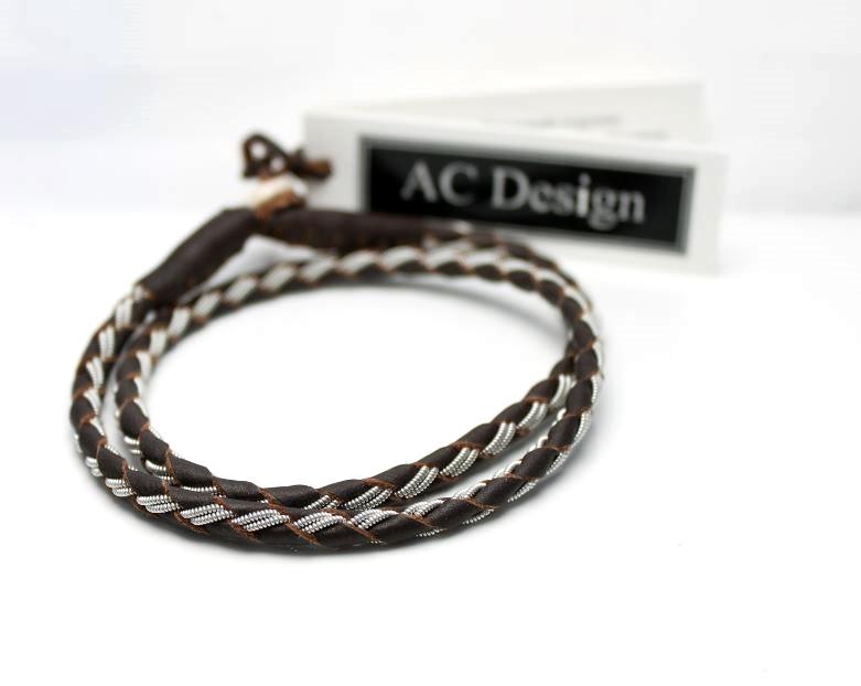 Sami bracelet wrap bracelet in reindeer leather and pewter wire.